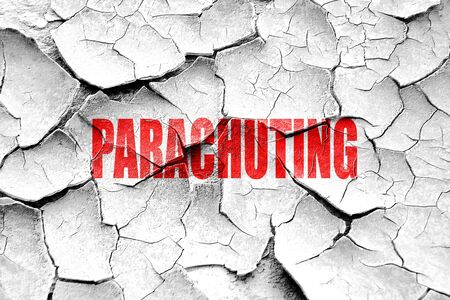 parachuting: Grunge cracked parachuting sign background with some soft smooth lines