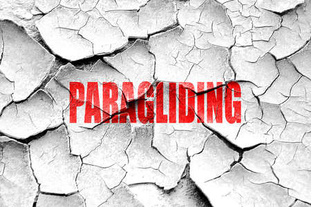 paragliding: Grunge cracked paragliding sign background with some soft smooth lines