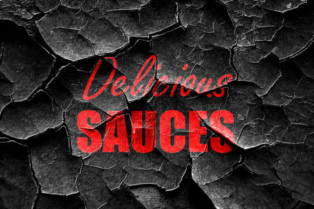 sauces: Grunge cracked Delicious sauces sign with some soft smooth lines Stock Photo