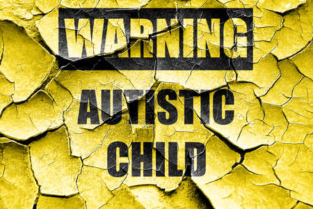autistic: Grunge cracked Autistic child sign with orange and black colors Stock Photo