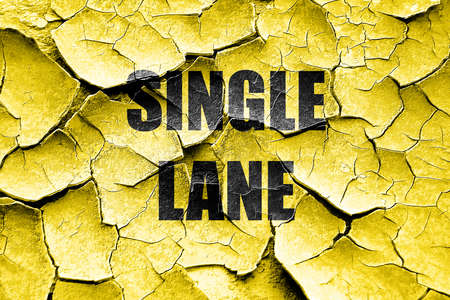 one lane street sign: Grunge cracked Single lane sign with yellow and black colors Stock Photo