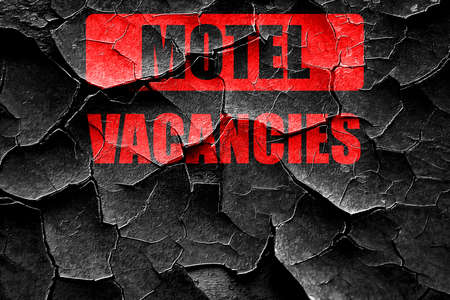 holidays vacancy: Grunge cracked Vacancy sign for motel with some soft glowing highlights