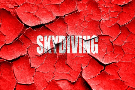skydiving: Grunge cracked skydiving sign background with some soft smooth lines