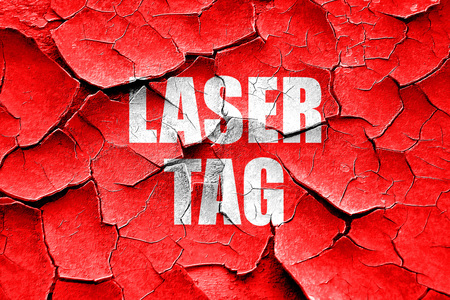 laser tag: Grunge cracked laser tag sign background with some soft smooth lines Stock Photo