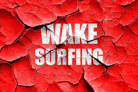 surf team: Grunge cracked wake surfing sign background with some soft smooth lines Stock Photo