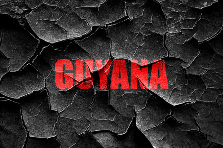 guyana: Grunge cracked Greetings from guyana card with some soft highlights Stock Photo
