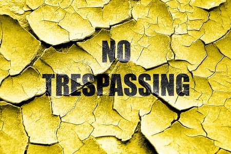 no trespassing: Grunge cracked No trespassing sign with black and orange colors