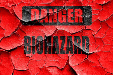 waste prevention: Grunge cracked Biohazard sign with some smooth lines