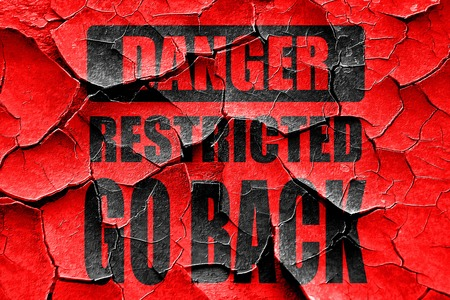 go back: Grunge cracked Go back sign with some smooth lines Stock Photo