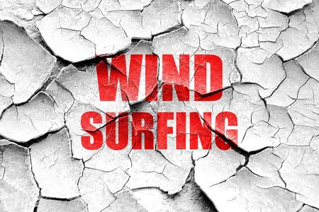 surf team: Grunge cracked wind surfing sign background with some soft smooth lines