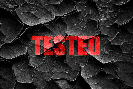 tested: Grunge cracked tested sign background with some soft smooth lines