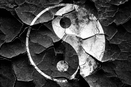 daoism: Grunge cracked Ying yang symbol with some soft smooth lines Stock Photo