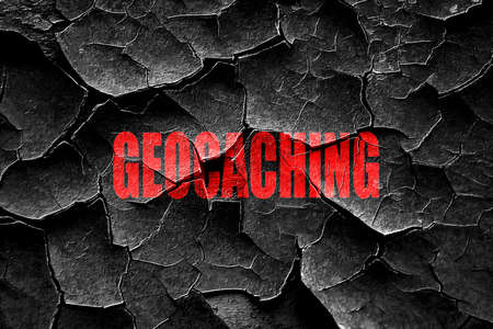 geocaching: Grunge cracked geocaching sign background with some soft smooth lines