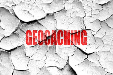 caching: Grunge cracked geocaching sign background with some soft smooth lines
