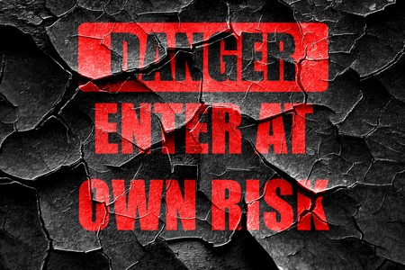 own: Grunge cracked enter at own risk sign with some soft lines