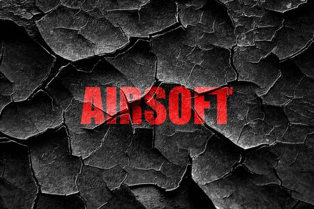 airsoft: Grunge cracked airsoft sign background with some soft smooth lines