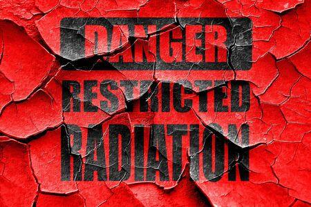 armageddon: Grunge cracked Nuclear danger background on a grunge background