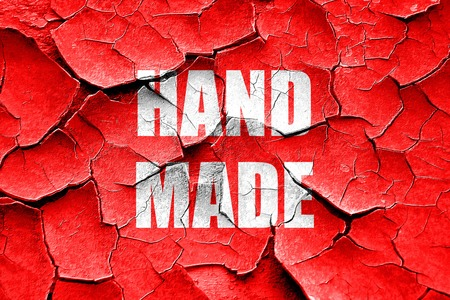 craftsperson: Grunge cracked hand made sign with some smooth lines Stock Photo