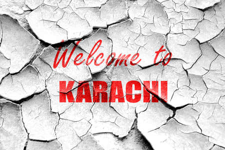 karachi: Grunge cracked Welcome to karachi with some smooth lines Stock Photo