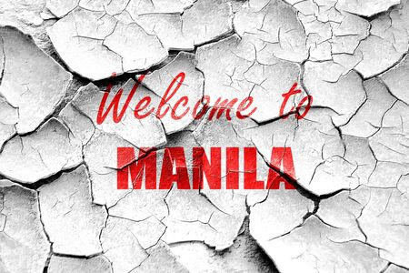 manila: Grunge cracked Welcome to manila with some smooth lines Stock Photo
