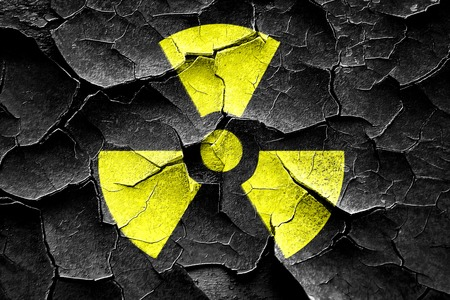 hazardous waste: Grunge cracked Nuclear danger background on a grunge background