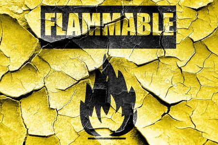burnable: Grunge cracked Flammable hazard sign with yellow and black colors