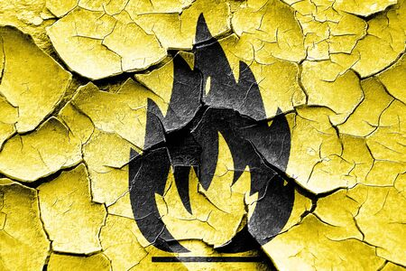 combustible: Grunge cracked Flammable hazard sign with yellow and black colors