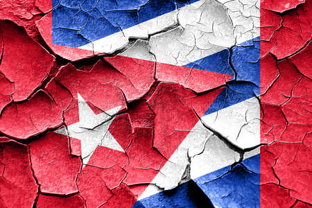 cuba flag: Grunge cracked Cuba flag with some soft highlights and folds Stock Photo