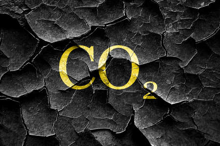 co2: Grunge cracked CO2 warning sign with yellow and black colors