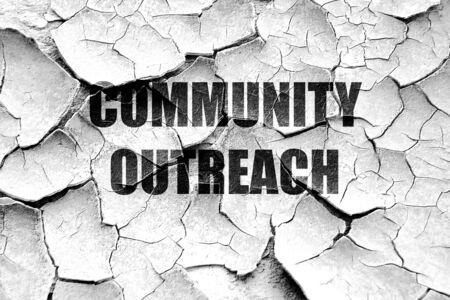 community outreach: Grunge cracked Community outreach sign with some smooth lines