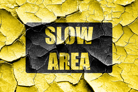 slow: Grunge cracked Yellow slow sign with black and yellow colors