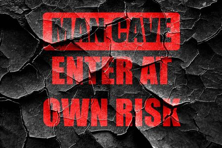 a cave: Grunge cracked man cave sign with some soft lines