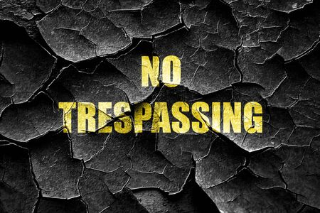trespassing: Grunge cracked No trespassing sign with black and orange colors