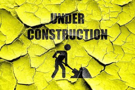 vivid colors: Grunge cracked Under construction sign with some vivid colors