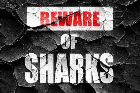 Grunge cracked Beware of sharks sign with some smooth lines
