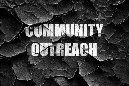 outreach: Grunge cracked Community outreach sign with some smooth lines