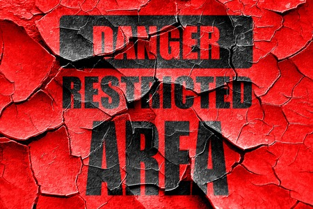 forbidden to pass: Grunge cracked Restricted area sign with some smooth lines Stock Photo