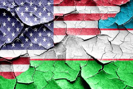 broken unity: Grunge Uzbekistan flag combined with american flag