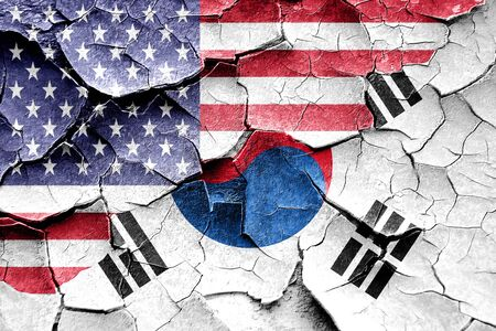 broken unity: Grunge South korea flag combined with american flag Stock Photo