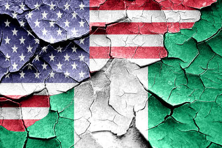 broken unity: Grunge Nigeria flag combined with american flag Stock Photo