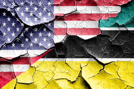 Grunge Mozambique flag combined with american flag Stock Photo
