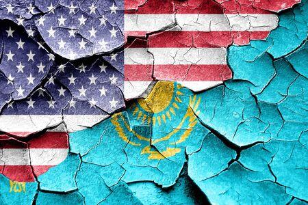 broken unity: Grunge Kazakhstan flag combined with american flag Stock Photo