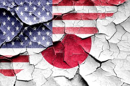 broken unity: Grunge Japan flag combined with american flag Stock Photo
