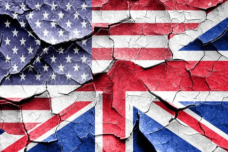 broken unity: Grunge Great britain flag combined with american flag Stock Photo