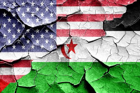 broken unity: Grunge Western sahara flag combined with american flag Stock Photo