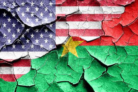 broken unity: Grunge Burkina Faso flag combined with american flag Stock Photo