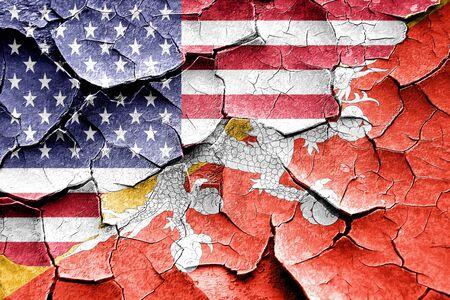 broken unity: Grunge Bhutan flag combined with american flag Stock Photo