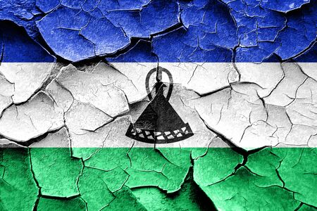 broken unity: Grunge Lesotho flag with some cracks and vintage look