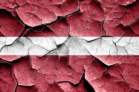 latvia flag: Grunge Latvia flag with some cracks and vintage look Stock Photo