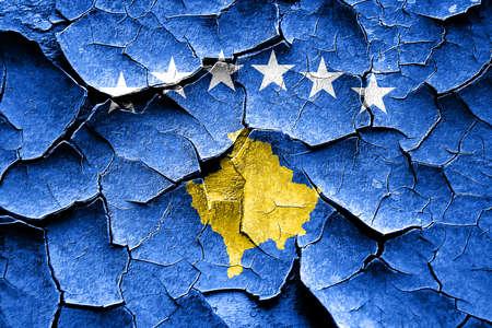 cracks: Grunge Kosovo flag with some cracks and vintage look